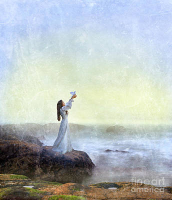 Young Lady Releasing A Dove By The Sea Art Print