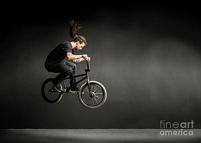 Mellow Yellow Rights Managed Images - Young man doing a stunt on his BMX bicycle. Royalty-Free Image by Michal Bednarek