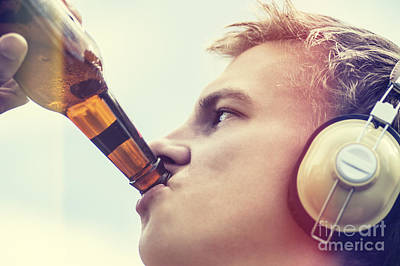 Beer Photos - Young man drinking beer and listening to music by Jorgo Photography - Wall Art Gallery