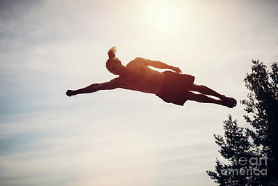 Health Photograph - Young Man Levitating In The Air. by Michal Bednarek