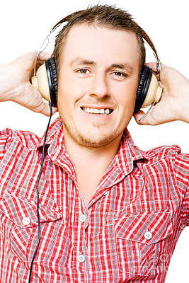 Youthful Photograph - Young Man Listening To Music Through Earphones by Jorgo Photography - Wall Art Gallery