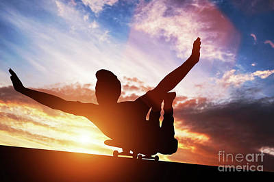 Photograph - Young Man Lying On Skateboard At Sunset. by Michal Bednarek