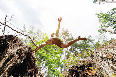 Skill Photograph - Young Man Making A Jump In The Forest. by Michal Bednarek