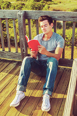 Photograph - Young Man Reading Book Outside by Alexander Image
