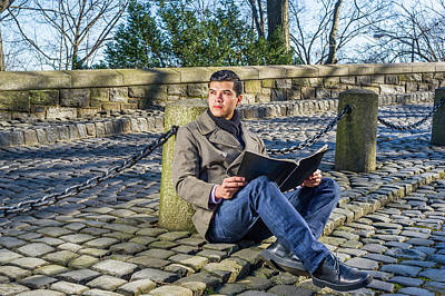 Photograph - Young Man Reading Magazine At Park by Alexander Image