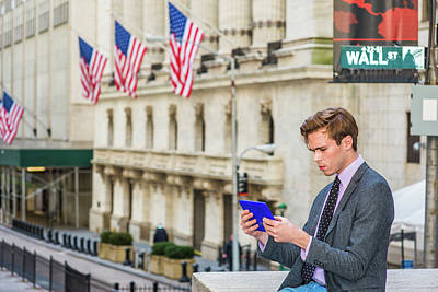 Photograph - Young Man Reading Tablet Computer On Wall Street In New York 1504129 by Alexander Image
