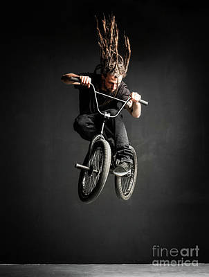 Photograph - Young Man With Dreadlocks Jumping On His Bmx Bike. by Michal Bednarek