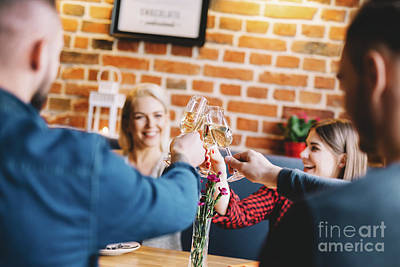Photograph - Young People Toasting And Laughing. by Michal Bednarek