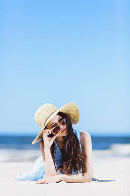 Photograph - Young Pretty Woman Laying On The Beach, Holding Her Sunglasses. by Michal Bednarek