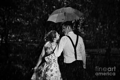 Umbrella Photograph - Young Romantic Couple In Love Flirting In Rain by Michal Bednarek