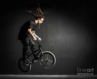 Photograph - Young Sportsman Doing Stunts On His Professional Bicycle. by Michal Bednarek