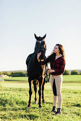Photograph - Young Woman Dressed Casually Petting Black Horse by Michal Bednarek