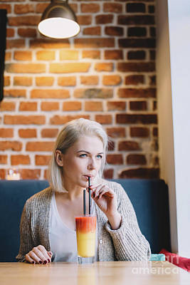Blondie Photograph - Young Woman Drinking Colorful Cocktail. by Michal Bednarek