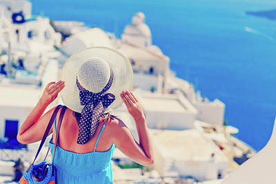 Luxury Photograph - young woman enjoying view of Santorini, Greece by NadyaEugene Photography