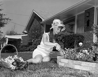 Photograph - Young Woman Gardening, C.1960s by H Armstrong Roberts and ClassicStock