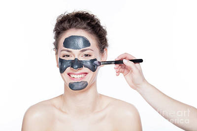 Photograph - Young Woman Having A Black Charcol Mask Applied On Her Skin. by Michal Bednarek