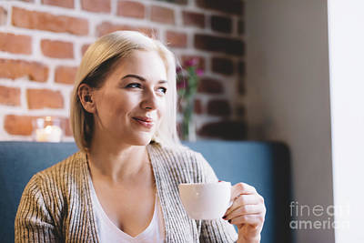 Photograph - Young Woman Holding A Cup Of Coffee. by Michal Bednarek