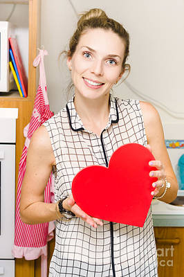 Young Woman In Mid 20s Holding Red Love Heart Art Print by Jorgo Photography - Wall Art Gallery
