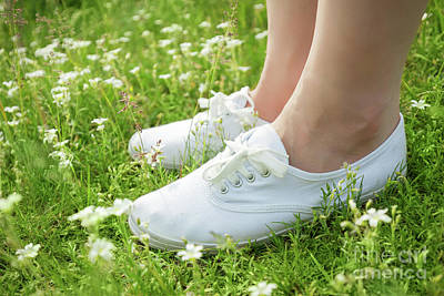 Foot Photograph - Young Woman In White Classic Sneakers Standing In Grass On Spring Meadow by Michal Bednarek