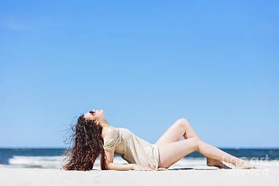Photograph - Young Woman Laying On The Beach, Sunbathing. by Michal Bednarek