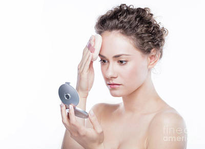 Photograph - Young Woman Putting Powder Foundation On Her Face. by Michal Bednarek