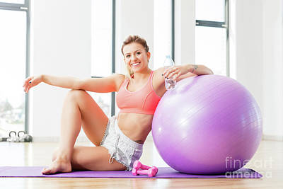 Energy Photograph - Young Woman Relaxing After Workout. by Michal Bednarek