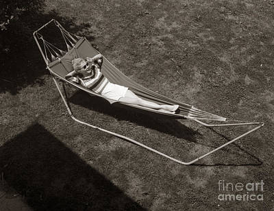 Photograph - Young Woman Relaxing In Hammock by Debrocke and ClassicStock