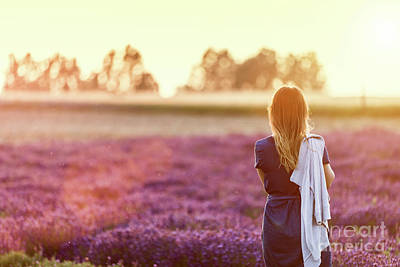 Photograph - Young Woman Relaxing Looking On Lavender Field At Sunset by Michal Bednarek