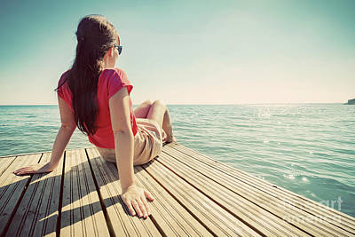 Photograph - Young Woman Resting On Jetty Looking At The Calm Sea On Sunny Summer Day. by Michal Bednarek