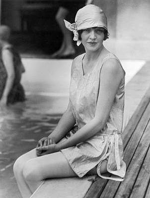 Swimsuit Photograph - Young Woman Sitting By Pool by Underwood Archives