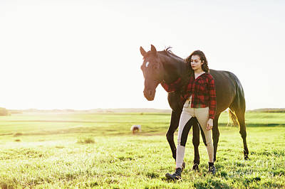 Photograph - Young Woman Standing Next To Her Black Horse by Michal Bednarek