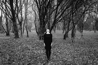 Photograph - Young Woman With Her Head Tilted Back While Standing In A Forest by Alexandre Rotenberg