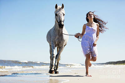Photograph - Young Woman Witth White Horse Running On The Beach by Michal Bednarek