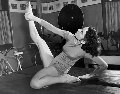 Leotard Photograph - Ziegfeld Dancer Stays Limber by Underwood Archives