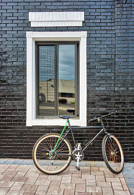 Photograph - Black Bike Against Black Brick Wall by Gary Slawsky
