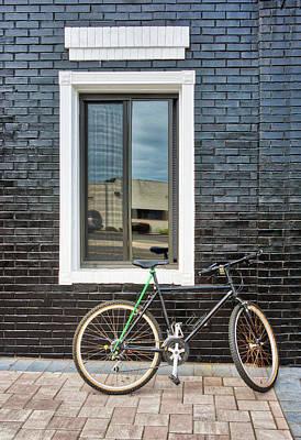 Photograph - Black Bike Against Black Brick Wall by Gary Slawsky