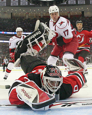 Photograph - Carolina Hurricanes V New Jersey Devils by Bruce Bennett