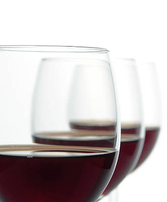 Pub Photograph - Close-up Of Three Red Wine Glasses by Domin domin
