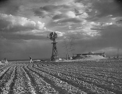 Photograph - Dust Storm Rising Over Farmer Walking Ac by Margaret Bourke-white
