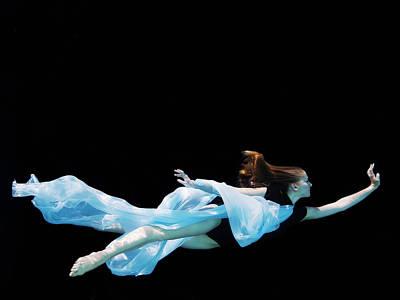 Balance Photograph - Female Dancer Underwater Against Black by Thomas Barwick
