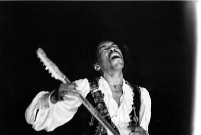 Photograph - Jimi Hendrix Performs At Monterey by Michael Ochs Archives