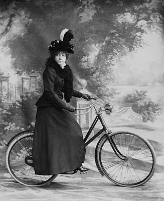 Boa Constrictor Wall Art - Photograph - Lady Cyclist by Rischgitz
