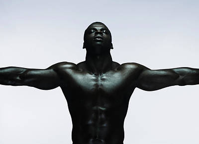 Eyes Closed Photograph - Muscular Man Standing With Arms Out by Flashpop
