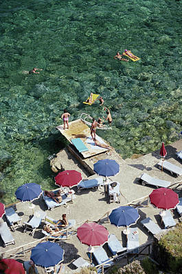 Porto Wall Art - Photograph - Porto Ercole Beach by Slim Aarons