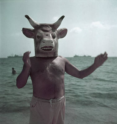 Photograph - Portrait Of Masked Picasson On The Beach by Gjon Mili