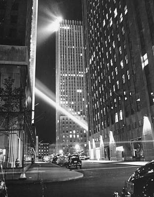 Photograph - Radio City Shining With Many Bright Ligh by Bernard Hoffman