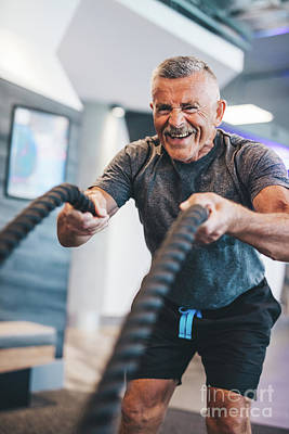 Photograph - Senior Man Exercising With Ropes At The Gym. by Michal Bednarek