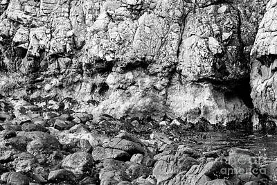 Photograph - strata of downfaulted basalt rock layers including red band formed of buried ashes Ballintoy county  by Joe Fox