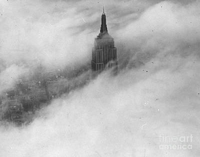 Photograph - The Top Of The Empire State Building by New York Daily News Archive