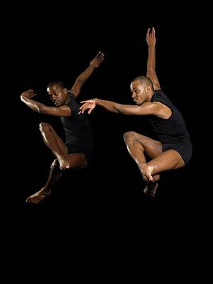 Photograph - Two Male Dancers Jumping by Image Source